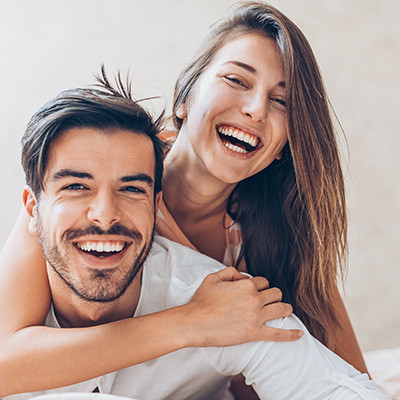 man and woman sitting together smiling