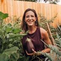 Nikki picking an eggplant