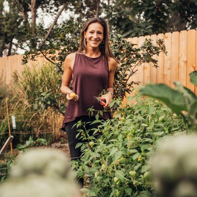 Nikki standing in the garden