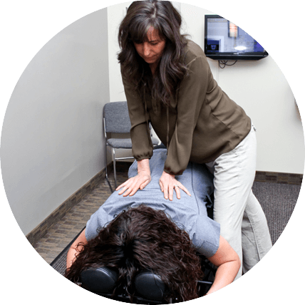 Dr. Christie adjusting patient
