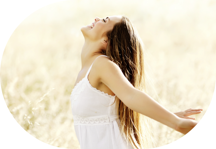woman smiling with arms outstretched
