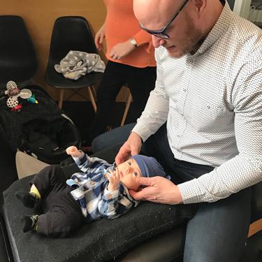 Dr Joel adjusting baby