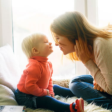 mom and child face to face