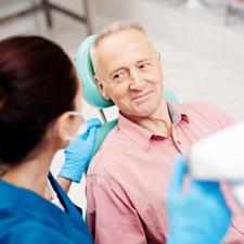 Man talking with female dentist