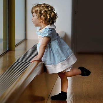 child leaning with one leg up