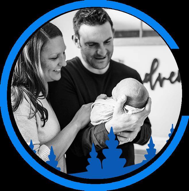 Dr. Aaron Neuerburg holding a baby