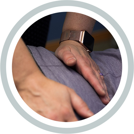 Hands on a patients back