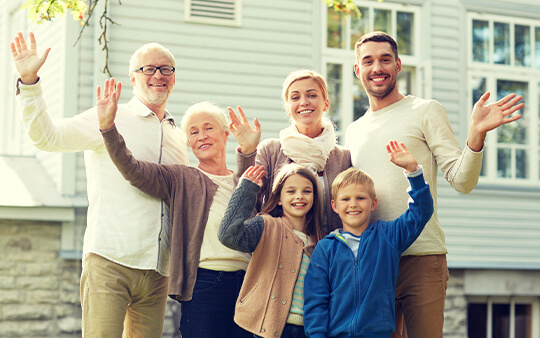 Three generations waving