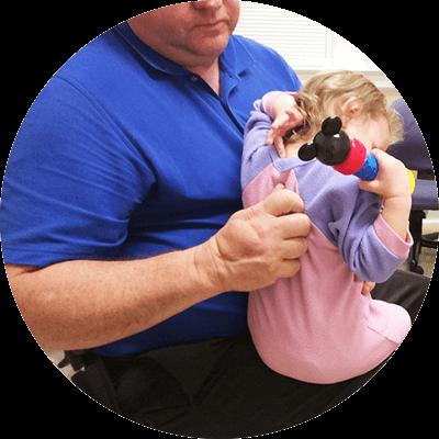 Dr Massey adjusting little girls back