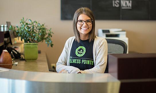 Tara at front desk
