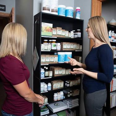 Dr showing patient supplements