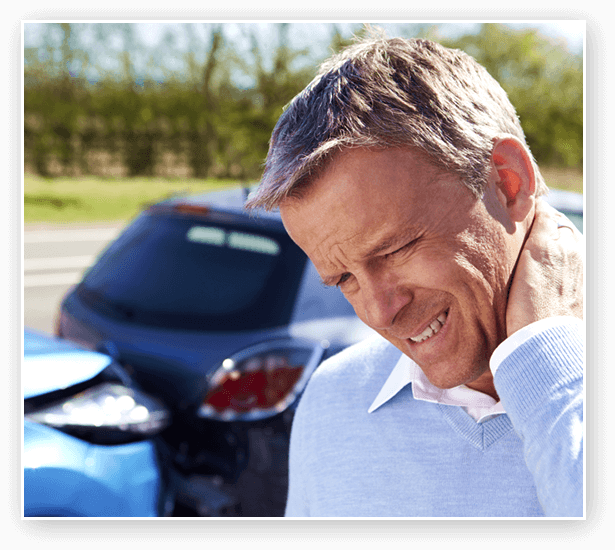 Man holding neck after accident