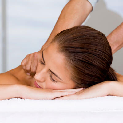 woman getting a shoulder and back massage