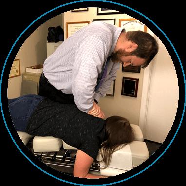 Dr. Brucks adjusting patient