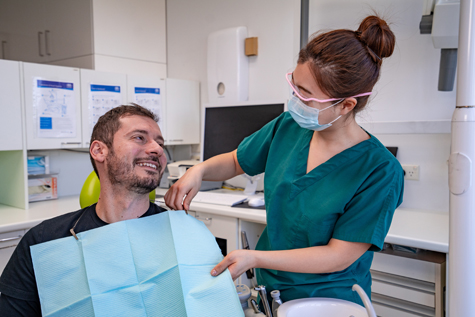 Male client on Dental Chair with dental assistant