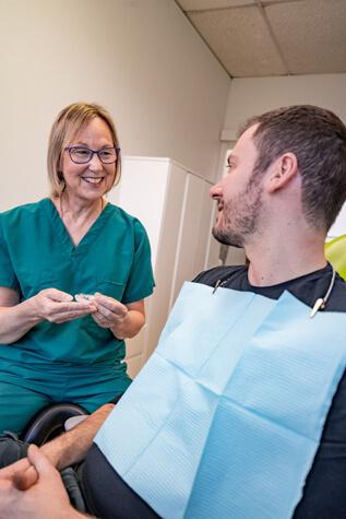 Dr Kemm with male patient