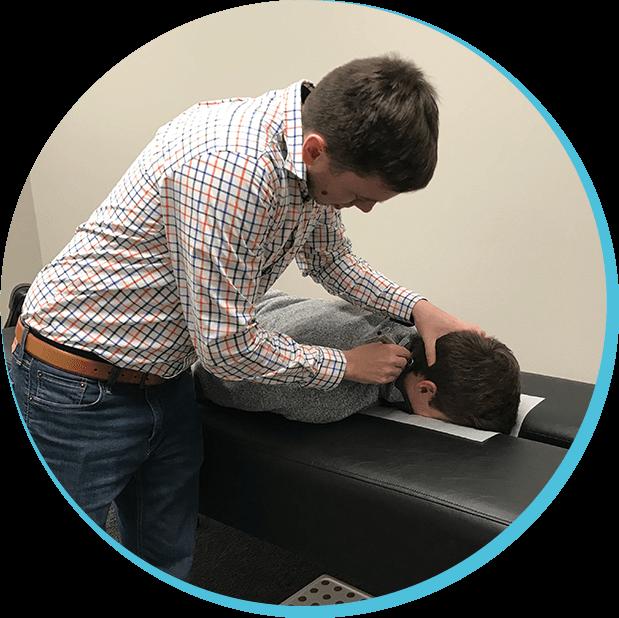 Dr. Taylor adjusting patient