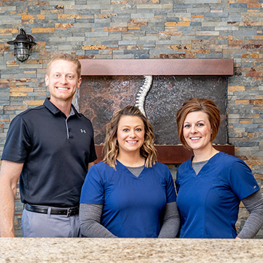 Engelken Chiropractic & Acupuncture team behind front desk