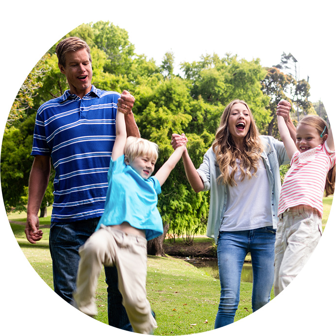 family holding hands and laughing