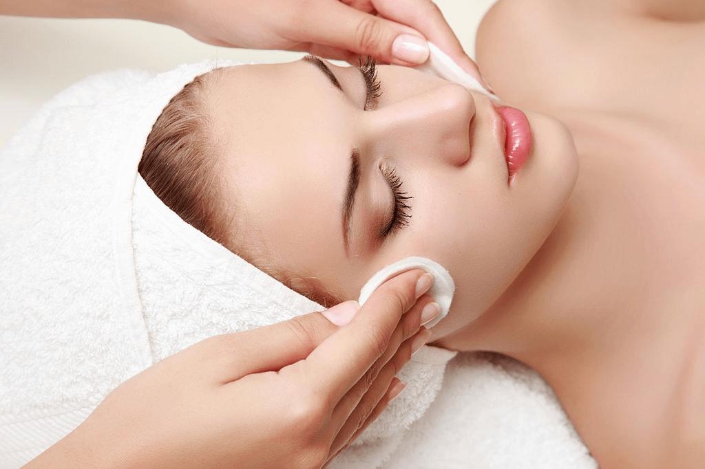 woman getting a facial on cheekbones