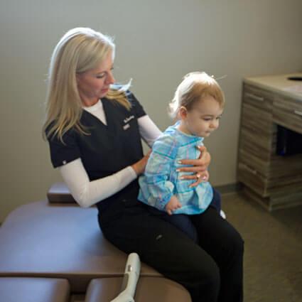 Dr. Townley adjusting toddler