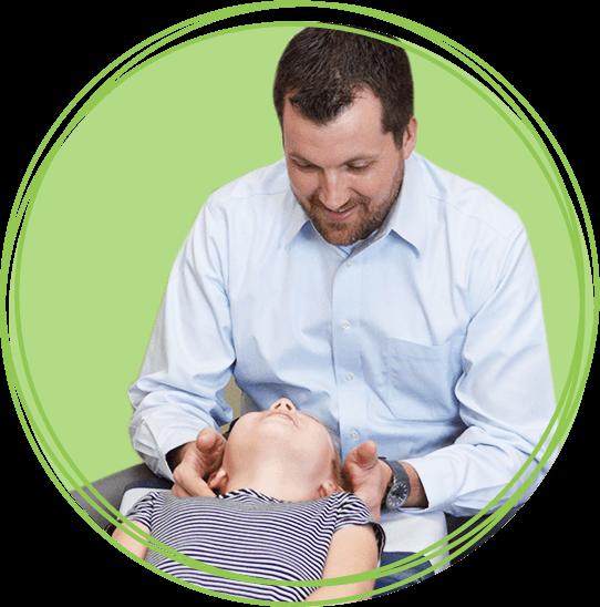 Dr. Matthew Cline adjusting girl