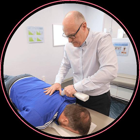 Dr. Bill using Activator on mans back