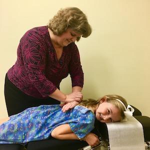 Dr Gray adjusting girls back