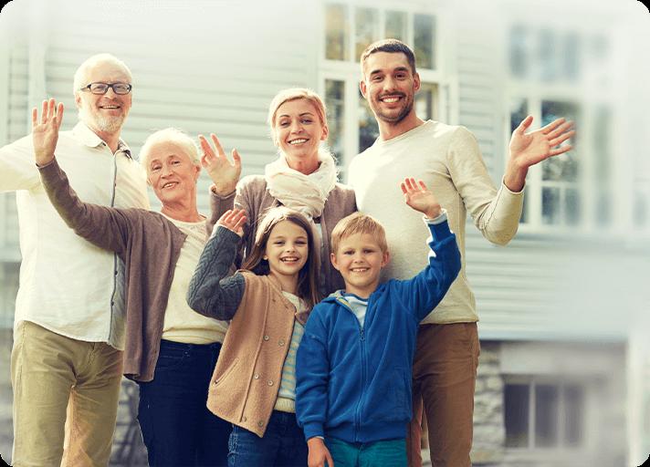 Multi-generational family waving