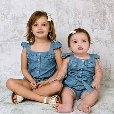 two small children in matching outfits