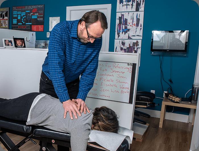 Dr. Colin adjusting patient