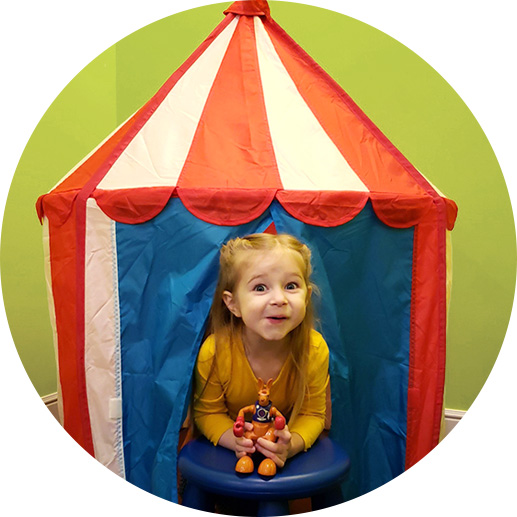 Little girl playing in tent