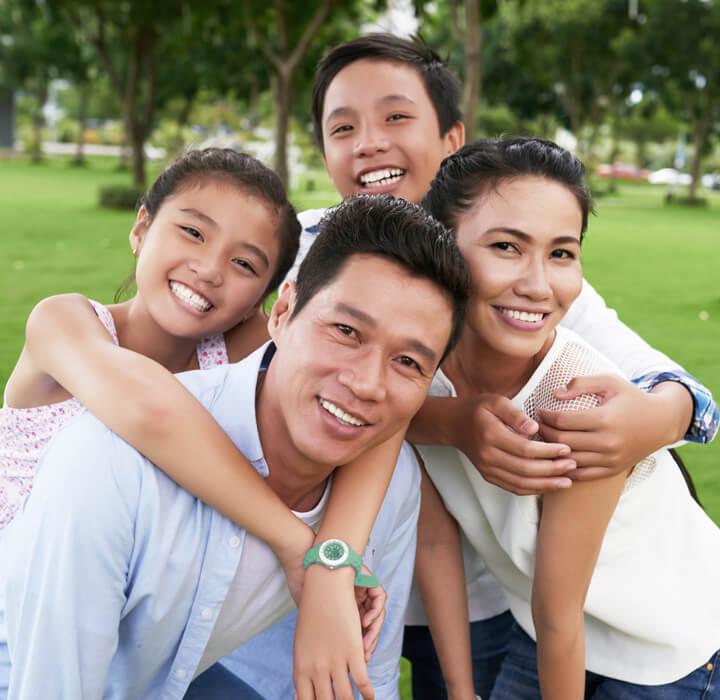 Smiling family in park