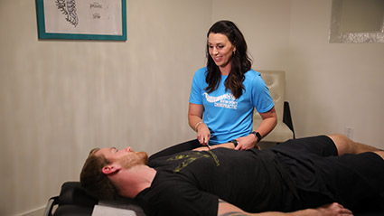 Dr Crystal adjusting man