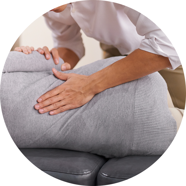 Hand on patient's low back