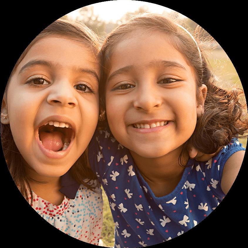 Little girls smiling in sun