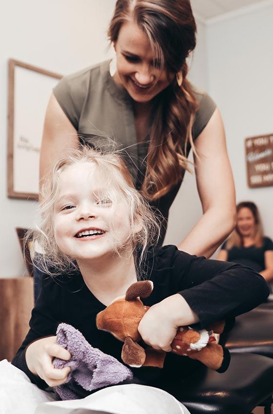 Dr. Brittney adjusting little girl