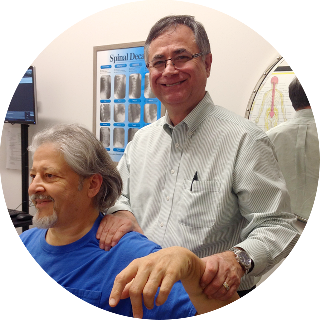 Dr. Longie examining patient arm