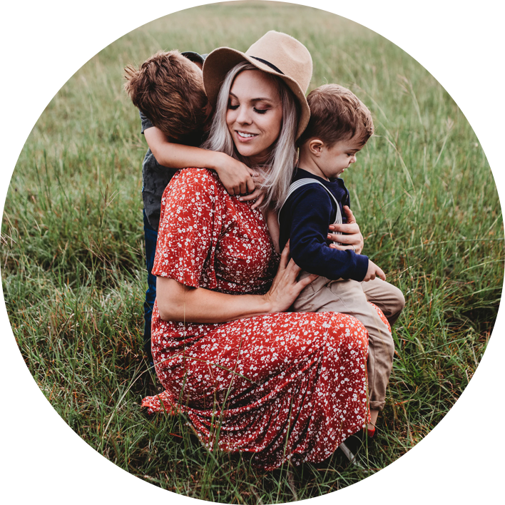 Mom in field with sons