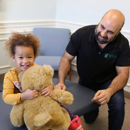 Dr. Triandos with little girl