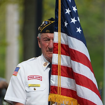 Old man honor guard holding the US flag