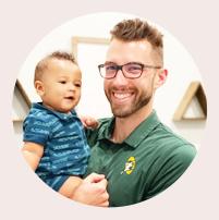 Dr. Brian holding little boy