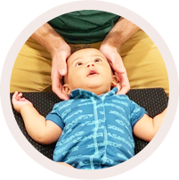 Baby getting neck adjustment