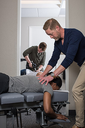 Doctors adjusting patients