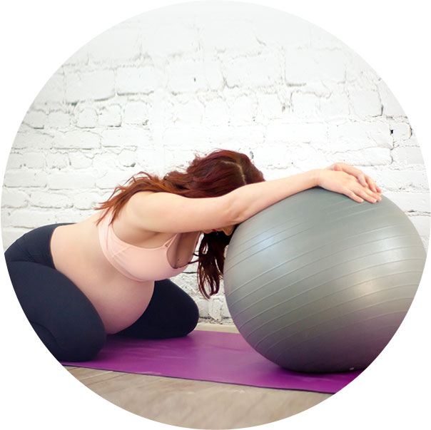 Woman stretching on ball