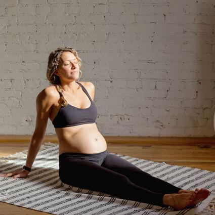 Woman sitting on mat