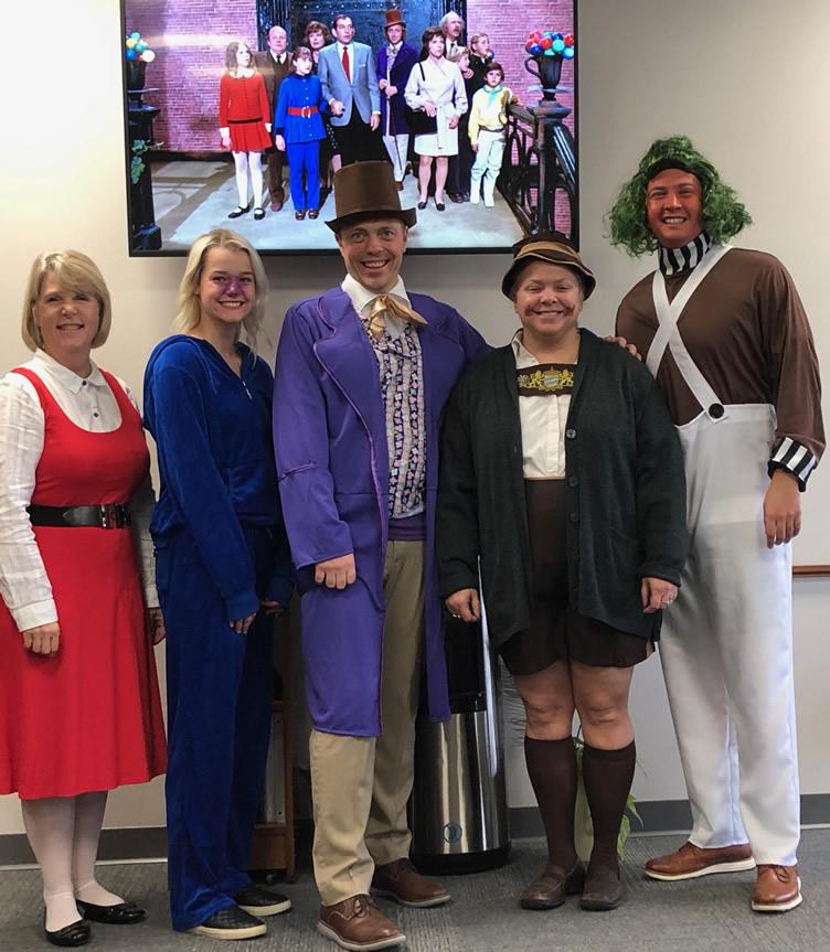 Team in Halloween costume