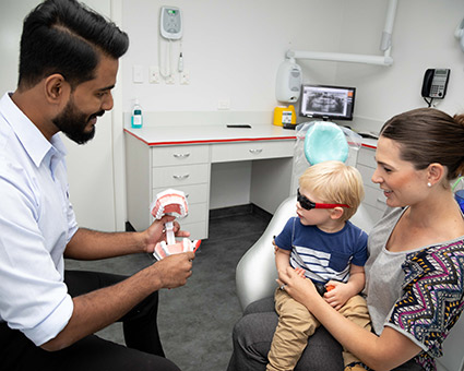 Dentist with toddler and mother