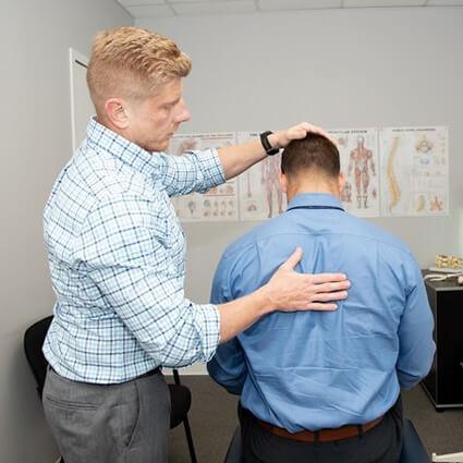 Doctor checking back