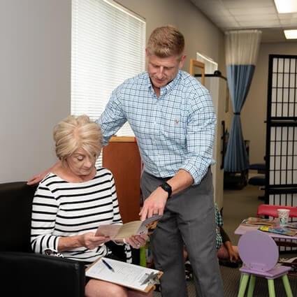 Dr. Scott reviews with patient